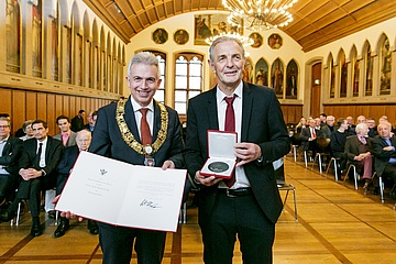 Bundesliga record player Karl-Heinz Körbel receives the badge of honor of the city of Frankfurt